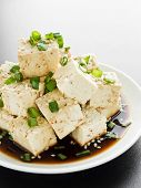 picture of soy sauce  - Plate with tofu cheese in soy sauce with green onion - JPG