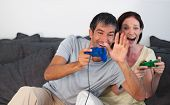 Couple On Sofa Playing Video Games poster