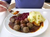 pic of meatballs  - Food being eaten. Swedish meatballs potatoes cranberry on dish. A traditional scandinavian culinary.