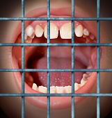 stock photo of indecent  - Censorship and free speech concept with a shouting or yelling human mouth behind prison bars as a symbol of a communication ban or banned from communication due to restrictions in the media guidlines and internet police - JPG