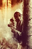 stock photo of gases  - Soldier wearing a gas mask is fighting for its survival - JPG