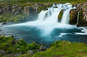 stock photo of waterfalls  - Dynjandi is the most famous waterfall of the West Fjords and one of the most beautiful waterfalls in the whole Iceland - JPG