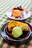 Icecream And Passion Fruit Cake On Black Plate