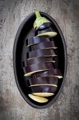 pic of aubergines  - Sliced eggplant or aubergine in black dish - JPG