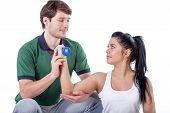 stock photo of elbow  - Young physiotherapist doing elbow exercises with his patient - JPG