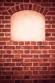 foto of niche  - Old stone arch arc niche with space for text frame in brick wall background - JPG