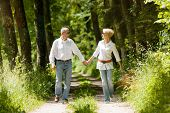 picture of early spring  - Mature or senior couple running - JPG