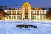 stock photo of winter palace  - Winter scenery of Abbots Palace in snowy park of Gdansk - JPG