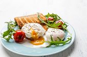 Poached Eggs with Wholegrain Bread Toasts and Vegetables