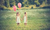 picture of tragic  - girls twin sisters in the meadow in the summer with balloons - JPG