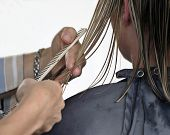 picture of hair cutting  - Hands of hairdresser cutting hair on white background - JPG