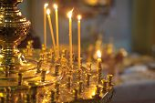 picture of church interior  - Burning candles in a Russian orthodox church. Close-up of ordinary church interior. Selective focus. ** Note: Shallow depth of field - JPG