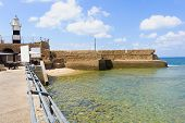 picture of crusader  - The lighthouse and an old Templars crusader fort in the old city of Acre Israel - JPG