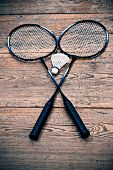 foto of shuttlecock  - Vintage badminton racquets with a shuttlecock on floor - JPG