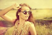 stock photo of hippies  - Romantic hippie girl standing in a field - JPG