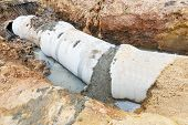 stock photo of septic  - Close up sewer system installation in city - JPG