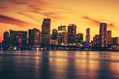 stock photo of florida-orange  - CIty of Miami at sunset with clouds in the sky - JPG