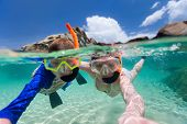 stock photo of virginity  - Split photo of mother and son family snorkeling in turquoise ocean water at tropical island - JPG