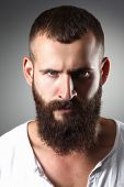 stock photo of hooligan  - Portrait of handsome bearded man standing - JPG