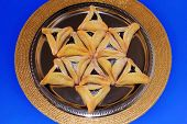 stock photo of purim  - magen david made from Hamantaschen cookies for Jewish festival of Purim - JPG