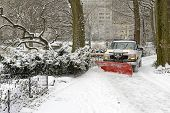 foto of snowy-road  - Truck with snowplow on road after snowstorm - JPG