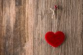 image of soulmate  - Red heart hanging on wooden texture background - JPG