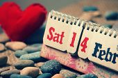 foto of special day  - Red heart symbol of love with desk calendar Feb 14 on it nice pebble fiber background with vintage color Valentine day is special day for lover with sweetheart - JPG