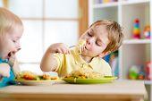 picture of nursery school child  - children eating healthy food in nursery or at home - JPG