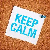 stock photo of calm  - Keep Calm Reminder Note Pinned to a Cork Memory Bulletin Board - JPG