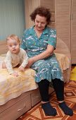 foto of bassinet  - grandmother with her grandson on a bed - JPG