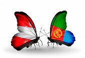 stock photo of eritrea  - Two butterflies with flags on wings as symbol of relations Austria and Eritrea - JPG