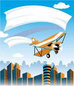 image of biplane  - Biplane flying over city with banner advertisement - JPG