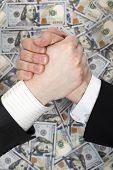 foto of two dollar bill  - Friendly handshake of two men in suits closeup on background hundred dollar banknotes - JPG