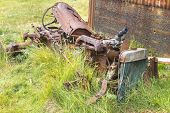 picture of derelict  - Abandoned derelict tractor in advanced stage of rusting to pieces - JPG