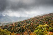 pic of asheville  - Fog rolls over a mountainside bright with leaves changing color in fall  - JPG