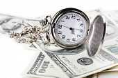 stock photo of american money  - Silver pocket clock and money close - JPG