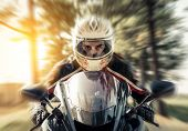 stock photo of acceleration  - man accelerate with his motorcycle on the street - JPG