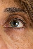 picture of close-up middle-aged woman  - Close up of a middle age woman green eye and skin aging - JPG