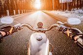 stock photo of slippery-roads  - Biker rides on winter slippery road - JPG