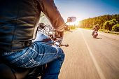 picture of biker  - Bikers driving a motorcycle rides along the asphalt road  - JPG