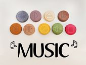 picture of musical symbol  - Symbols and signs set used on music players and in music as general carved into colorful mscaroons cookies - JPG