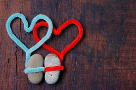 stock photo of love hurts  - Colourful harmony Valentine background amazing style heart on pebble I love you message on wooden red color Valentine day on Feb 14 is the day for couple they give lovely gift for lover - JPG