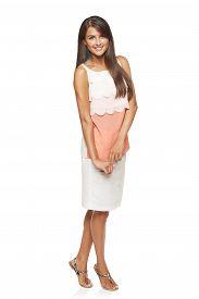 pic of flirty  - Full length flirty elegant woman in dress over white background - JPG