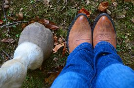 picture of cowgirl  - Horse hoof next to a girl wearing cowgirl boots - JPG
