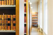 foto of academia  - Old Vintage Books On A Wooden Shelfs In Library - JPG