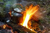 foto of kettles  - Marching kettle on a fire in the forest - JPG