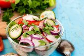 image of chinese parsley  - Spring salad with radishes cucumber Chinese cabbage and red onion closeup  on a blue wooden background - JPG