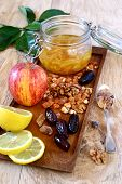 image of dry fruit  - Lemon jam in a glass jar fruit nuts and dried fruits on a wooden tray - JPG