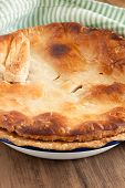 picture of crust  - Home baked pie with a golden puff pastry crust baked in enamelware pie dish can be used for savory or sweet fillings - JPG
