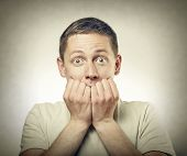 stock photo of scared  - Portrait of amazed or scared man - JPG